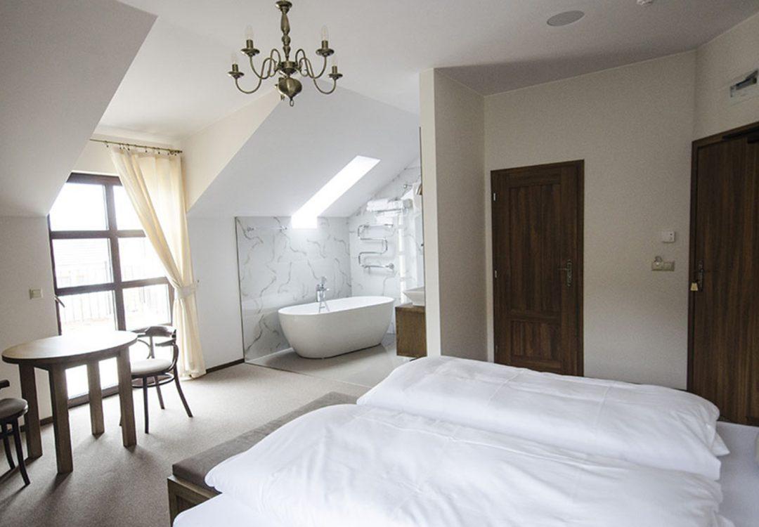 novomanzelske-apartma-postel-1